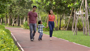 Happy Asian Family Walking In The Park stock footage