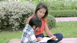 Asian Mother Teaching Her Son To Read - Dolly Shot stock footage