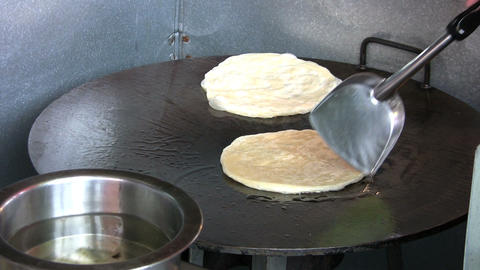 Frying Roti Bread stock footage