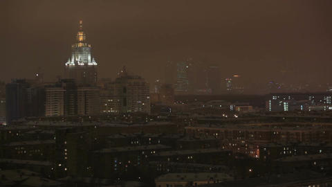 Main building of Moscow State University at night winter in Moscow, Russia, view through window Footage