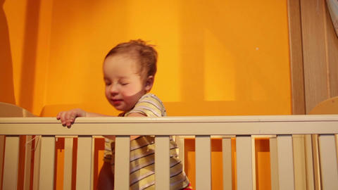 Boy Plays With Balloon In The Playpen stock footage