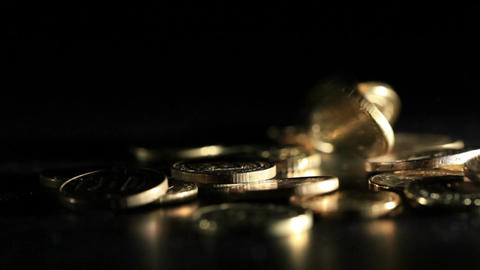 Gold Coins Falling Over Dark Background. Macro Shot stock footage
