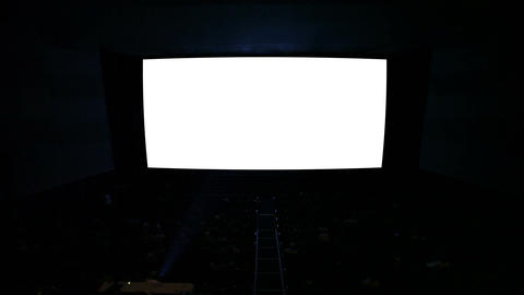 White cinema screen with projector light and audience in a modern cinema house Footage