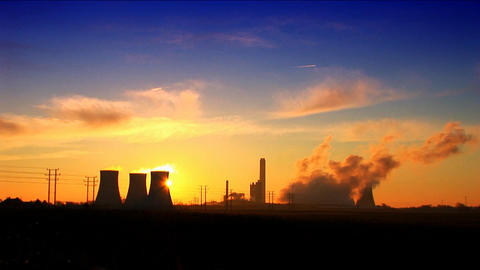 Sun Rises Above A Coal Fired Power Station stock footage