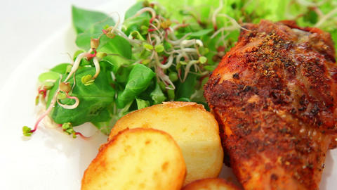 Roasted Chicken Leg With Potatos Sprouts Salad And Tomatoes stock footage