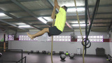 Athlete Making Leg Less Rope Climb Crossfit Exercise stock footage