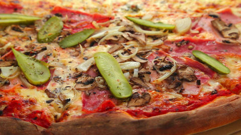 Delicious Pizza With Ham And Vegetables stock footage
