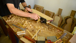 Luthier giving wood planer in workplace Footage