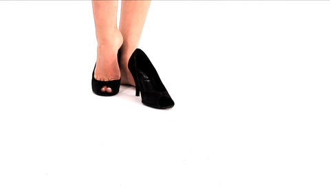 Woman Taking Off Her Shoes And Having A Rest stock footage