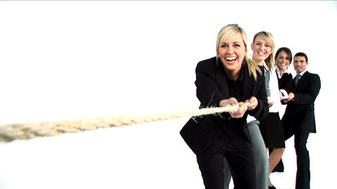Team Pulling A Rope In A Tug Of War stock footage