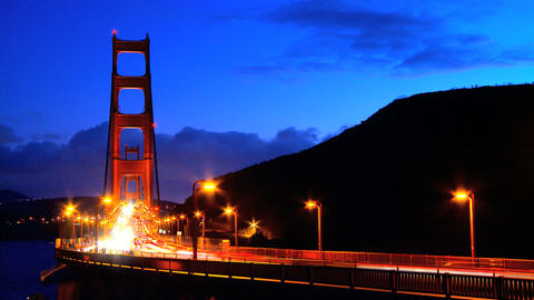 Timelapse of busy night traffic crossing the Golden Gate Bridge Footage