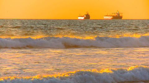 Oil tankers at sea at sunset Footage