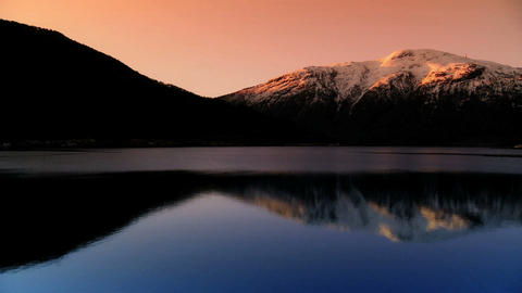 Time-lapse Sunrise Over A Glacial Fjord stock footage