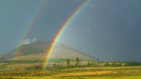 A Double Rainbow Shines Over A Field stock footage