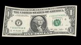 US One Dollar Bill Blowing In The Wind stock footage