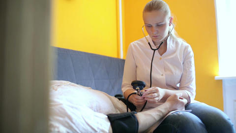 Doctor Measures The Blood Pressure At Home stock footage
