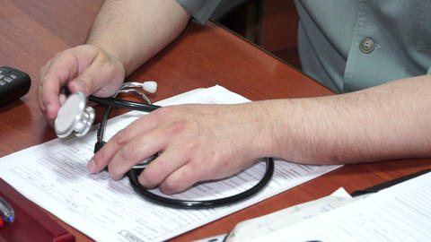 Stethoscope at the hands of the doctor Footage