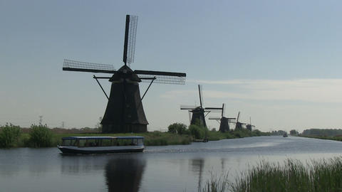 Dutch windmills and tourist boat Footage
