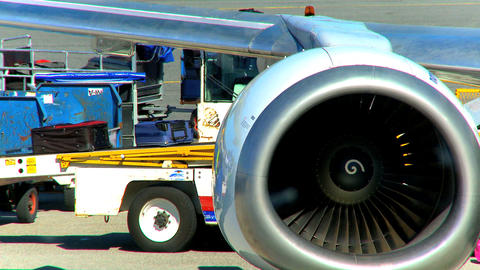 Commercial Jet Airliner Unloading Passenger Baggage stock footage