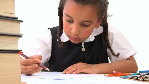 Cute African American Schoolgirl Early Learning With Colored Pencils stock footage