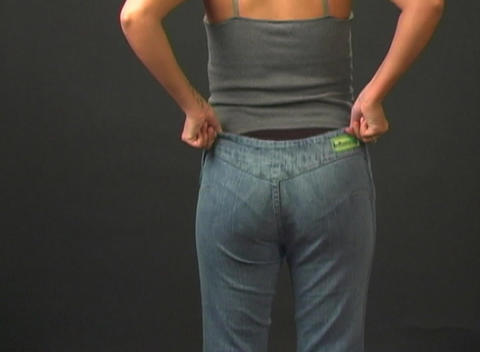Putting on Her Jeans - Rear View Footage