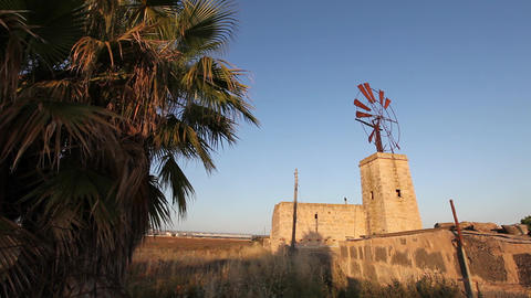 Windmill On Top Of A Rural Building stock footage