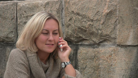 Woman Talking On The Phone stock footage
