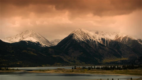 (1118) Autumn Early Snow Storm - Sunrise Timelapse Of Mountains And Aspen Colors stock footage