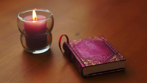 Romantic Book And Candle Rack Focus stock footage