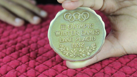 Girl Holds Olympic Gold Medal stock footage