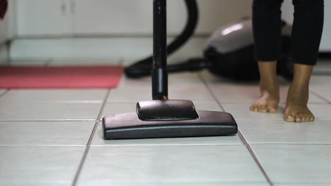 Little Girl Vacuuming Kitchen Floor Low Angle Footage