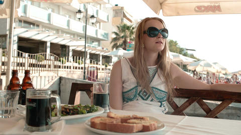 Young Woman Having A Meal In An Outdoor Restaurant stock footage