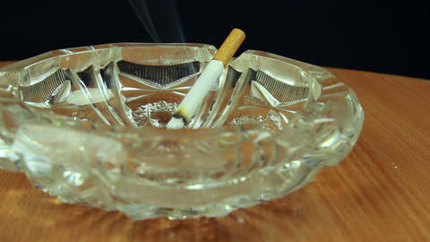 Smoking Cigarette In Ashtray Dolly Shot Front View stock footage