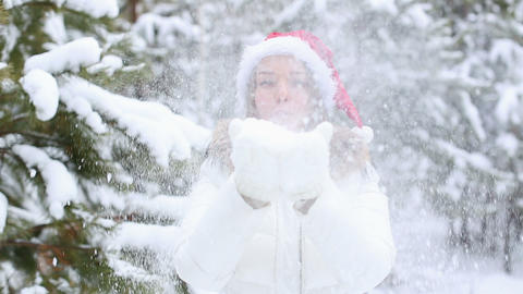 Friendly Woman Blowing Snowflakes stock footage