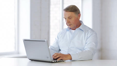 Old Man Working With Laptop At Home stock footage