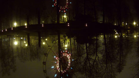 Ferris Wheel At Night Reflected In The Water stock footage