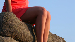 Woman Sitting On Rock stock footage