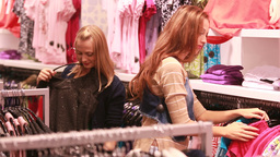 Attractive Female Friends Shopping In Mall stock footage
