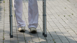 Nursing Home Patient Walking With Help Of Walker stock footage