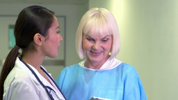Lovely Young Doctor Showing Promising Test Results To Her Elderly Patient stock footage