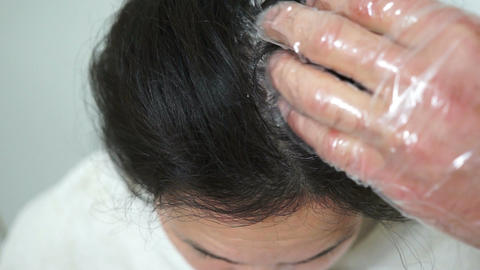 Woman Hair Roots Dyeing stock footage