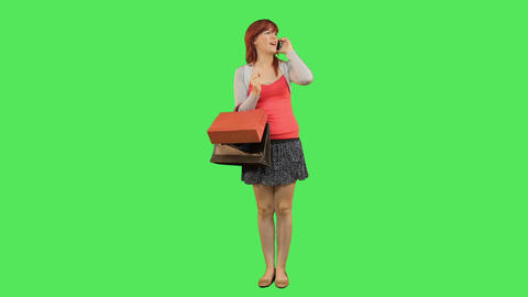Female Callling And Holding Shopping Bags stock footage