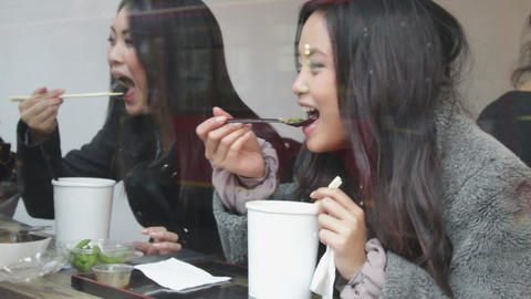 Asian Female Friends Eating Noodles stock footage
