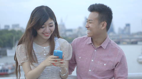 Young Couple Using Cell Phone stock footage