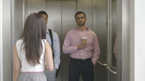 Men and women in lift Footage