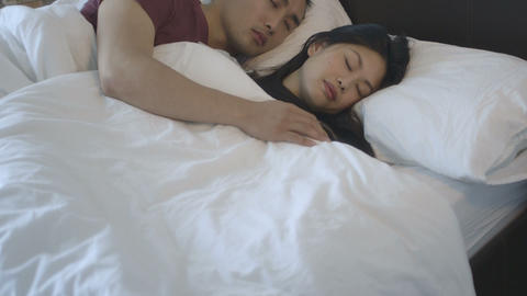 Couple Sleeping In Bed stock footage