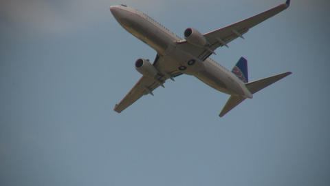Closeup Of A Commercial Jet Ascending Through The Blue Sky stock footage