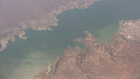 Aerial Shot Of A Body Of Water Amidst Rocky Landscape stock footage