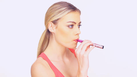 Young woman smoking an e-cigarette Footage