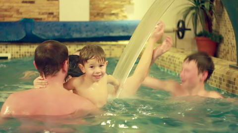 Family In Pool stock footage